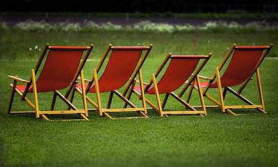 Red Deck Chairs On The Green Lawn Art Print by Mikhail Pankov