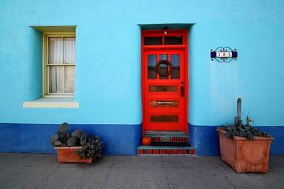 Red Door On Blue Wall Art Print by Joe Kozlowski