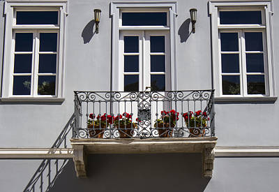 Photograph - Red Flowers On The Balcony by Radoslav Nedelchev