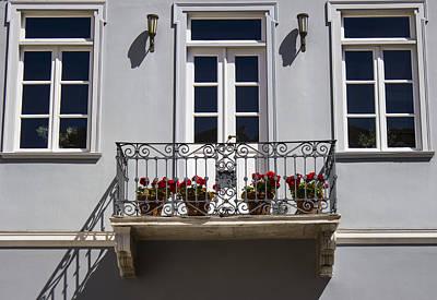 Photograph - Red Flowers On The Balcony by Radoslav Nedelchev