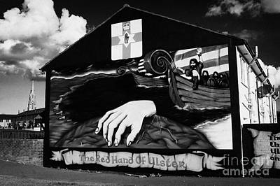 red hand ulster loyalist murals in the Lower Shankill Road area of West Belfast Northern Ireland Art Print