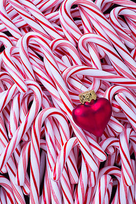 Abundance Photograph - Red Heart Ornament On Candy Canes by Garry Gay