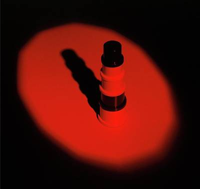 Single Object Photograph - Red Light Shining On Object by Dorling Kindersley/uig