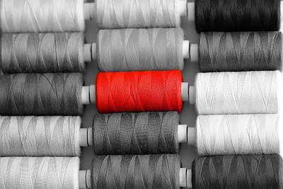 Photograph - Red Sewing Thread Stands Out From Grey by Manuela Schewe-behnisch / Eyeem