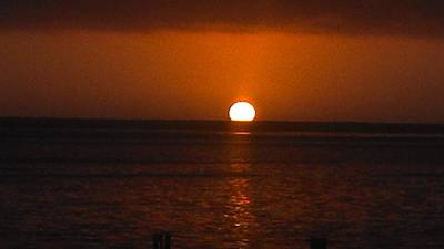 Robert Walker Photograph - Red Sun Sets by Robert Walker