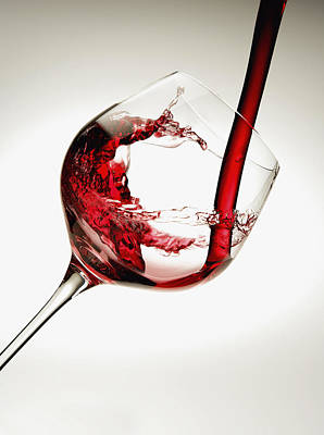 Red Wine Pouring Into A Glass Art Print by Richard Desmarais