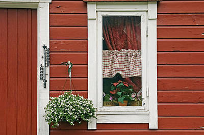 Red Wooden House With Plants In And By Print by Chris Parker