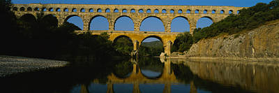 Reflection Of An Arch Bridge Art Print by Panoramic Images