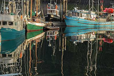 Queen Charlotte Islands Photograph - Reflection Of Boast In The Water by Macduff Everton