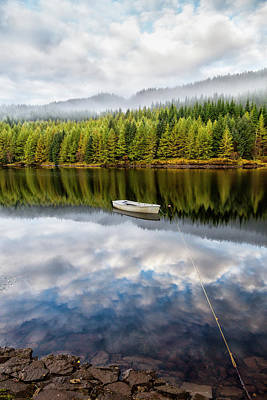 Photograph - Reflection Of Boat And Trees by Jonathan Irish