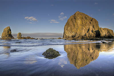 Sun Photograph - Reflection Of Haystack Rock At Cannon Beach 3 by David Gn