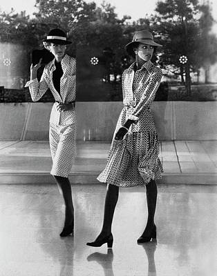 Photograph - Reflection Of Models Wearing Patterned Skirts by Kourken Pakchanian