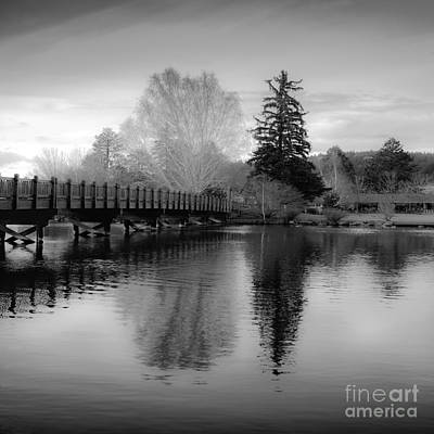 Photograph - Reflection Of Scenic Wooden Bridge And Trees On The Deschutes by Jerry Cowart