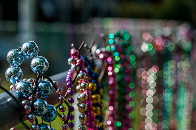 Photograph - Reflections In Mardi Gras Beads by Andy Crawford