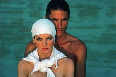 Young Man Photograph - Rene Russo And Male Model Wearing Sun Wear by Francesco Scavullo