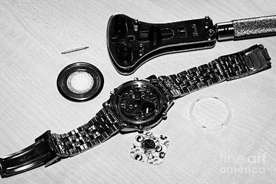 Replacing The Battery In A Metal Band Wristwatch Art Print by Joe Fox