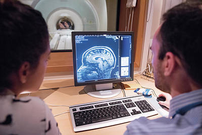Researchers Looking At Brain Imaging Data Art Print by John Cairns Photography/oxford University Images