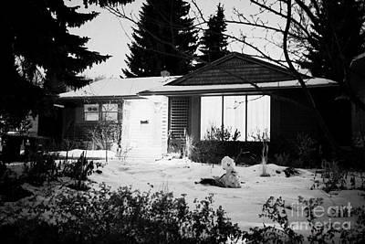 residential home at night in the snow with porch light on Saskatoon Saskatchewan Canada Art Print