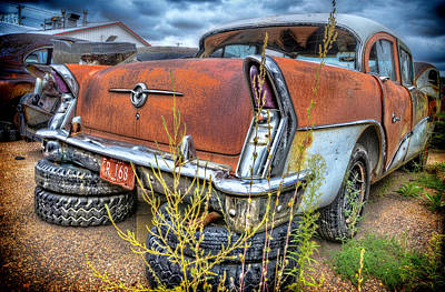 Resting On Tires Art Print by Ken Smith