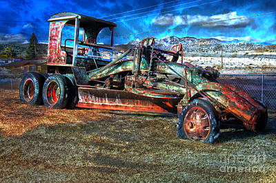 Photograph - Retired Caterpillar by Gunter Nezhoda