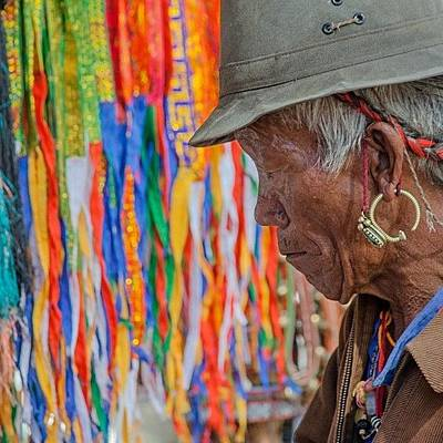 Colourful Wall Art - Photograph - Ribbons And Old Man by Hitendra SINKAR
