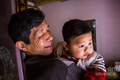 Photograph - Ricepaper Maker And Grand Son by Rick Bragan