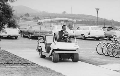 Richard Nixon Driving A Golf Cart Art Print by Everett