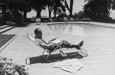 Clemente Photograph - Richard Nixon Reading Newspapers While by Everett