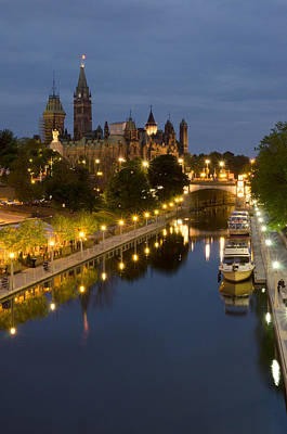 Rideau Canal And The Parliament Buildings At Night Art Print by Rob Huntley