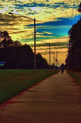 Photograph - Riding Into The Sunset by Tyson Kinnison