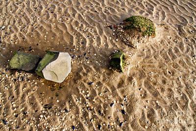 Ebbtide Photograph - Rippled Beach With Stones. by Jan Brons