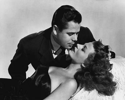 Kelly Photograph - Rita Hayworth About To Be Kissed by Retro Images Archive