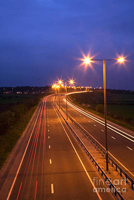 Carriageway Photograph - Road And Traffic At Night by Colin and Linda McKie