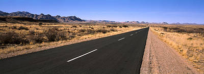 Road Passing Through A Desert Art Print