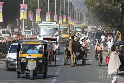 Road Traffic In India Art Print by Tony Camacho