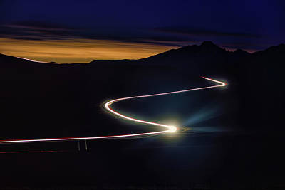 Photograph - Road With Headlights In Rocky Mountain by Keith Ladzinski