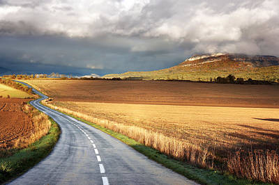 Road With Stormy Clouds Art Print by Mikel Martinez de Osaba