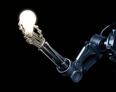 Robotic Hand Holding A Lightbulb Print by Andrzej Wojcicki