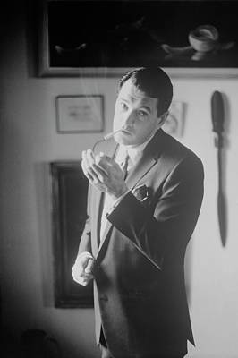 Sterling Photograph - Rock Hudson Lighting A Cigarette by John Bryson