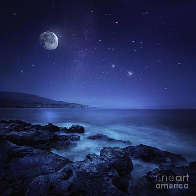Rocks Seaside Against Rising Moon Print by Evgeny Kuklev