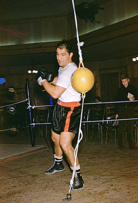 Punching Photograph - Rocky Marciano Training Hard by Retro Images Archive