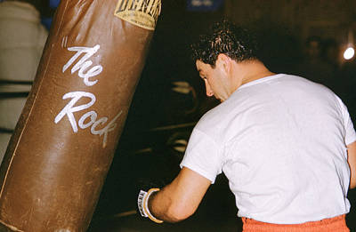 Striking Photograph - Rocky Marciano Vs. Heavy Bag by Retro Images Archive