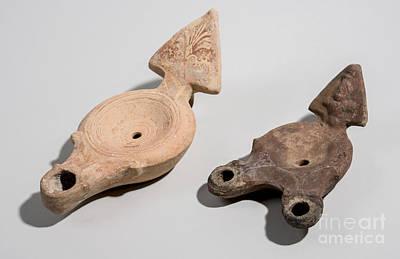 Ancient Roman Oil Lamp Photograph - Roman Terracotta Oil Lamps by Ilan Amihai