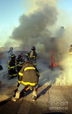 Photograph - Roof Operations At A 4th Alarm Apartment House Fire by Steven Spak