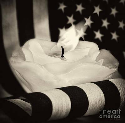 Rose Candle On American Flag Art Print by Iris Richardson