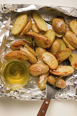 Rosemary Potatoes On Aluminium Foil With Spatula And Olive Oil Art Print