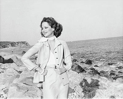 Rosie Vela Wearing A Jacket On A Beach Art Print by Francesco Scavullo