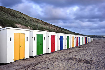 Row Of Colorful Beach Huts  Print by Matthew Gibson