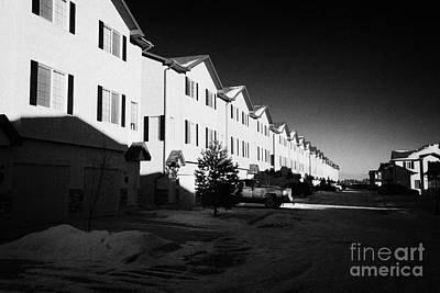 row of condominium starter homes during winter Saskatoon Saskatchewan Canada Art Print