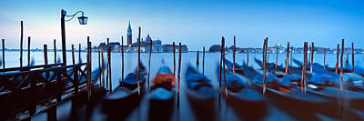 In A Row Photograph - Row Of Gondolas Moored Near A Jetty by Panoramic Images